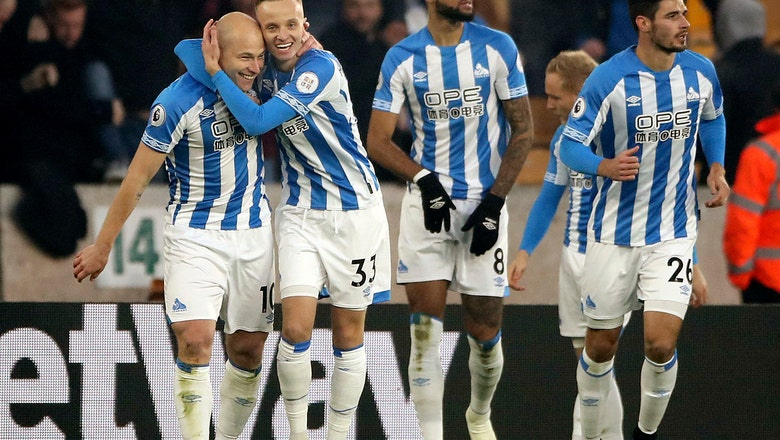 Mooy scores 2 as Huddersfield jumps to 14th from last