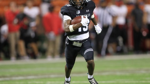 <p>               Hawaii wide receiver JoJo Ward (19) runs the ball for a touchdown to tie the game against UNLV during the fourth quarter of an NCAA college football game, Saturday, Nov. 17, 2018, in Honolulu. Hawaii would go on to defeat UNLV 35-28. (AP Photo/Marco Garcia)             </p>