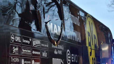 <p>               FILE - In this April 11, 2017 file photo a window of Dortmund's team bus is damaged after an explosion before the Champions League quarterfinal soccer match between Borussia Dortmund and AS Monaco in Dortmund, Germany. The court in Dortmund is expected to pass sentence on Tuesday, Nov. 21, 2018 against a German man on charges of setting of explosives to gamble with options on Dortmund shares. (AP Photo/Martin Meissner,file)             </p>