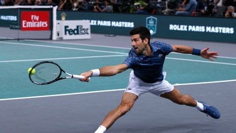 <p>               Novak Djokovic of Serbia stretches for the ball return it to Karen Khachanov of Russia during their final match of the Paris Masters tennis tournament at the Bercy Arena in Paris, France, Sunday, Nov. 4, 2018. (AP Photo/Thibault Camus)             </p>