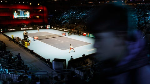 <p>               A boy walks along the stands as Jaume Munar of Spain plays Hubert Hurkacz of Poland , during the ATP Next Gen tennis tournament, at the Rho fair, near Milan, Italy, Wednesday, Nov. 7, 2018. The even is featuring many of the innovations that debuted last year such as free movement for spectators who can get up and walk around during matches, except behind the baseline. (AP Photo/Luca Bruno)             </p>