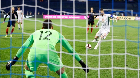 <p>               Spain's Sergio Ramos scores his side's second goal from the penalty spot past Croatia goalkeeper Lovre Kalinic during the UEFA Nations League soccer match between Croatia and Spain at the Maksimir stadium in Zagreb, Croatia, Thursday, Nov. 15, 2018. (AP Photo/Darko Bandic)             </p>