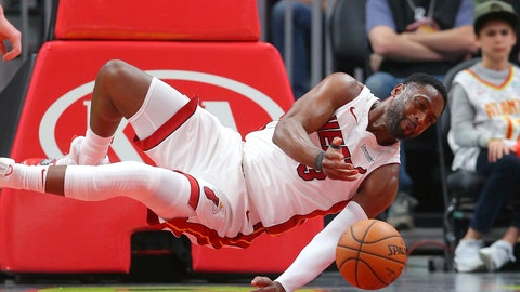 <p>               Miami Heat guard Dwyane Wade (3) dives for a loose ball during the first half of an NBA basketball game against the Atlanta Hawks Saturday, Nov. 3, 2018, in Atlanta. (AP Photo/John Bazemore)             </p>