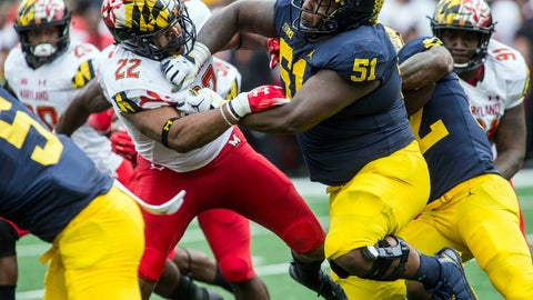 <p>               In this Oct. 6, 2018 photo, Michigan center Cesar Ruiz (51) blocks Maryland linebacker Isaiah Davis (22) during an NCAA college football game in Ann Arbor, Mich. When Ruiz left New Jersey to visit IMG Academy in Florida, his mother said he wasn't coming back home with her. Ruiz will be back in his home state this week when the fourth-ranked Wolverines play at Rutgers. (AP Photo/Tony Ding)             </p>