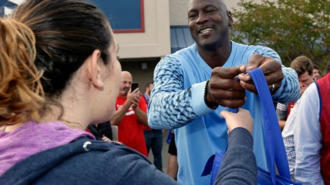 <p>               Charlotte Hornets owner Michael Jordan greets people and hands out food for Thanksgiving to members of the community in Wilmington, N.C., Tuesday, Nov. 20, 2018. (AP Photo/Gerry Broome)             </p>