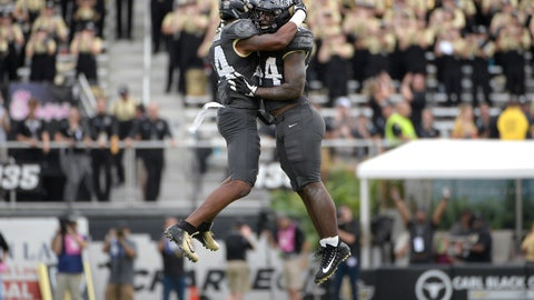 """<p>               FILE - In this Nov. 10, 2018, file photo, Central Florida linebacker Gabriel Luyanda, left, and linebacker Nate Evans celebrate after the team recovered a fumble during the first half of an NCAA college football game against Navy, in Orlando, Fla. No. 11 Central Florida has won 22 straight games and is making a run at another major bowl bid. ESPN's """"College GameDay"""" is coming to the schools' Orlando, Florida, campus this week. (AP Photo/Phelan M. Ebenhack)             </p>"""