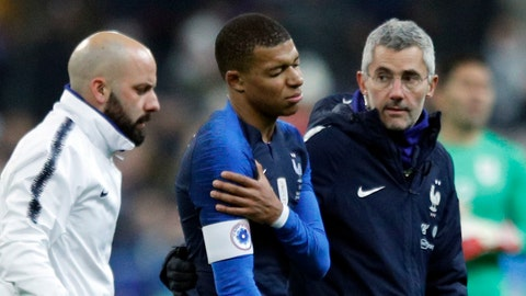 <p>               France's Kylian Mbappe, center, leaves the pitch injured during the international friendly soccer match between France and Uruguay at the Stade de France stadium in Saint-Denis, outside Paris, Tuesday, Nov. 20, 2018. (AP Photo/Francois Mori)             </p>