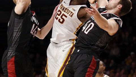 <p>               Minnesota's Daniel Oturu (25) rebounds against Nebraska-Omaha's Mitchell Hahn (44) and Matt Pile (40) during an NCAA college basketball game Tuesday, Nov. 6, 2018, in Minneapolis. (AP Photo/Stacy Bengs)             </p>