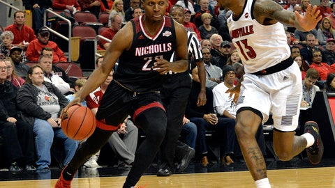 <p>               Nicholls State forward Brandon Moore Jr. (22) attempts to drive past the defense of Louisville forward V.J. King (13) during the first half of an NCAA college basketball game, in Louisville, Ky., Thursday, Nov. 8, 2018. (AP Photo/Timothy D. Easley)             </p>