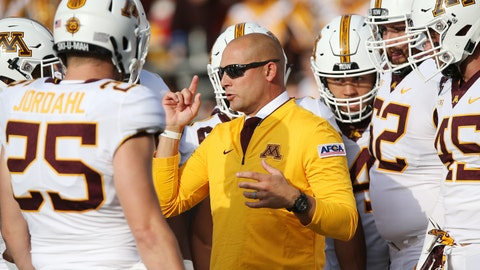 <p>               FILE - In this Thursday, Aug. 30, 2018 file photo, Minnesota head coach P.J. Fleck talks with his team prior to an NCAA college football game against New Mexico State in Minneapolis. Minnesota coach P.J. Fleck watched big play after big play by Illinois last weekend and knew a change was needed. The Illini's first two drives each culminated with a 72-yard touchdown run by Reggie Corbin. Fleck fired defensive coordinator Robb Smith on Sunday, Nov. 4, 2018.(AP Photo/Stacy Bengs, File)             </p>