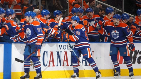 <p>               Edmonton Oilers' Oscar Klefbom (77), Ryan Nugent-Hopkins (93) and Leon Draisaitl (29) celebrate a goal against the Los Angles Kings during the third period of an NHL hockey game Thursday, Nov. 29, 2018, in Edmonton, Alberta. (Jason Franson/The Canadian Press via AP)             </p>