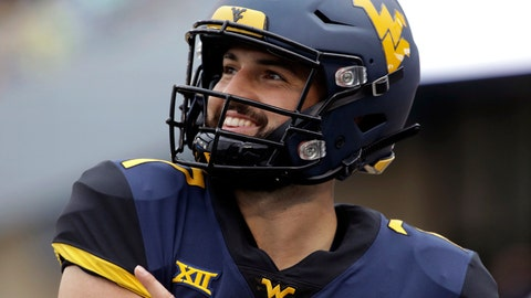 <p>               FILE - In this Sept. 8, 2018, file photo, West Virginia quarterback Will Grier (7) smiles during an NCAA college football game against Youngstown State, in Morgantown, W.Va. Grier, a senior, will play in his final home game Friday night, Nov. 23,  when No. 12 West Virginia hosts No. 6 Oklahoma.  (AP Photo/Raymond Thompson, File)             </p>