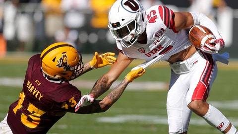 <p>               Arizona State safety Jalen Harvey (43) holds on for a tackle of Utah wide receiver Samson Nacua in the first half during an NCAA college football game, Saturday, Nov 3, 2018, in Tempe, Ariz. (AP Photo/Rick Scuteri)             </p>