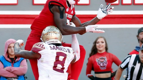 <p>               North Carolina State's Kelvin Harmon (3) hauls in a pass for a touchdown against Florida State's Stanford Samuels III (8) during the first half of an NCAA college football game in Raleigh, N.C., Saturday, Nov. 3, 2018. (AP Photo/Chris Seward)             </p>