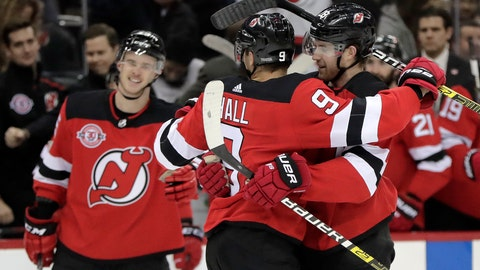 <p>               New Jersey Devils defenseman Damon Severson, right, is congratulated by Taylor Hall, center, after he scored a goal during the second period of an NHL hockey game against the Pittsburgh Penguins, Tuesday, Nov. 13, 2018, in Newark, N.J. (AP Photo/Julio Cortez)             </p>