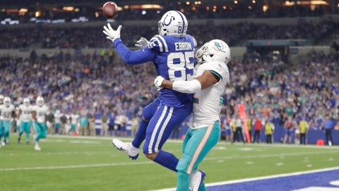 <p>               Indianapolis Colts tight end Eric Ebron (85) makes a touchdown catch over Miami Dolphins strong safety T.J. McDonald, right, during the first half of an NFL football game in Indianapolis, Sunday, Nov. 25, 2018. (AP Photo/Michael Conroy)             </p>