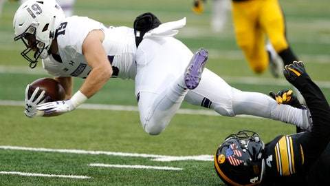 <p>               Northwestern wide receiver Riley Lees, left,  is tackled by Iowa's Josh Turner, right,  while returning a punt during the first half of an NCAA college football game, Saturday, Nov. 10, 2018, in Iowa City, Iowa. (AP Photo/Charlie Neibergall)             </p>