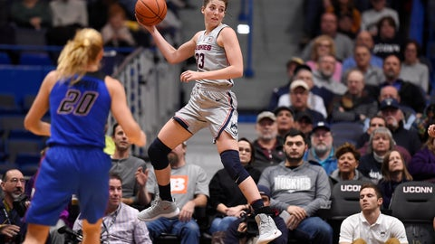 <p>               Connecticut's Katie Lou Samuelson leaps to keep a ball in play as DePaul guard Kelly Campbell (20) looks on during the first half of an NCAA college basketball game in Hartford, Conn., Wednesday, Nov. 28, 2018. (AP Photo/Jessica Hill)             </p>