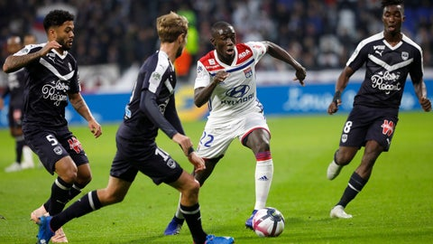 <p>               Lyon's Ferland Mendy, center, challenges for the ball with Bordeaux' players during their French League One soccer match in Decines, near Lyon, central France, Saturday, Nov. 3, 2018. (AP Photo/Laurent Cipriani)             </p>