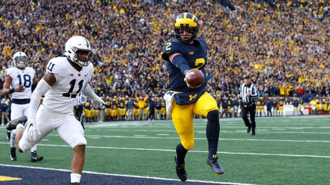 <p>               Michigan quarterback Shea Patterson (2) scores on a one-yard touchdown run as Penn State linebacker Micah Parsons (11) defends in the first half of an NCAA college football game in Ann Arbor, Mich., Saturday, Nov. 3, 2018. (AP Photo/Paul Sancya)             </p>