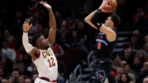 <p>               Chicago Bulls guard Zach LaVine, right, shoots against Cleveland Cavaliers guard David Nwaba during the first half of an NBA basketball game Saturday, Nov. 10, 2018, in Chicago. The Bulls won 99-98. (AP Photo/Nam Y. Huh)             </p>