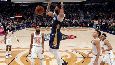 <p>               New Orleans Pelicans forward Anthony Davis (23) slam dunks in front of New York Knicks center Mitchell Robinson (26) in the first half of an NBA basketball game in New Orleans, Friday, Nov. 16, 2018. (AP Photo/Gerald Herbert)             </p>