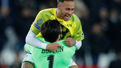 <p>               PSG forward Neymar, wearing the t-shirt of Liverpool goalkeeper Alisson celebrates with PSG goalkeeper Gianluigi Buffon after the Champions League Group C soccer match between Paris Saint Germain and Liverpool at the Parc des Princes stadium in Paris, Wednesday, Nov. 28, 2018. (AP Photo/Francois Mori)             </p>