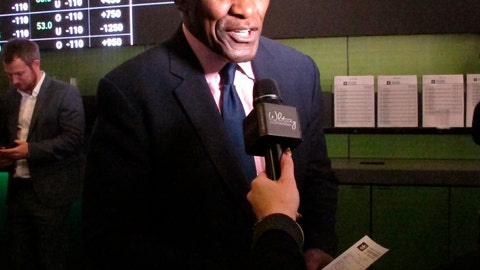 <p>               In this Nov. 20, 2018, photo, former New York Giants linebacker Harry Carson discusses a sports bet he had just placed on the New York Yankees to win the 2019 World Series at Resorts Casino in Atlantic City, N.J. Numerous U.S. states are considering joining the seven states that currently offer legal sports betting. (AP Photo/Wayne Parry)             </p>