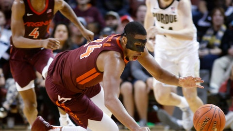 <p>               Virginia Tech's Kerry Blackshear Jr., center, dives for a loose ball during the second half of the team's NCAA college basketball game against Purdue at the Charleston Classic in Charleston, S.C., Sunday, Nov. 18, 2018. Virginia Tech won 89-83. (AP Photo/Mic Smith)             </p>
