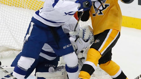 <p>               Pittsburgh Penguins' Patric Hornqvist (72) works against Tampa Bay Lightning's Anthony Cirelli (71) in front of Lightning goalie Louis Domingue during the first period of an NHL hockey game in Pittsburgh, Thursday, Nov. 15, 2018. (AP Photo/Gene J. Puskar)             </p>