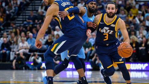 <p>               Utah Jazz guard Ricky Rubio (3) drives around teammate Rudy Gobert (27) and Memphis Grizzlies guard Mike Conley (11) during the second half of an NBA basketball game Friday, Nov. 2, 2018, in Salt Lake City. (AP Photo/Alex Goodlett)             </p>
