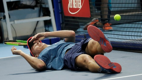 <p>               Alex De Minaur, of Australia, falls as he plays against Stefanos Tsitsipas of Greece, during the ATP Next Gen tennis tournament final, at the Rho fair, near Milan, Italy, Saturday, Nov. 10, 2018. (AP Photo/Luca Bruno)             </p>