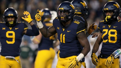 <p>               FILE - In this Oct. 25, 2018, file photo, West Virginia linebacker David Long Jr. (11) celebrates with his teammates after sacking Baylor's quarterback during the first half of an NCAA college football game, in Morgantown, W. Va. The Mountaineers' leading tackler is coming off his best game of the season. He had four tackles for loss and three sacks in a rout of TCU last week. (AP Photo/Raymond Thompson, File)             </p>