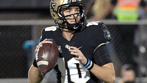 <p>               Central Florida quarterback McKenzie Milton (10) sets up to throw a pass during the first half of an NCAA college football game against Cincinnati, Saturday, Nov. 17, 2018, in Orlando, Fla. (AP Photo/Phelan M. Ebenhack)             </p>