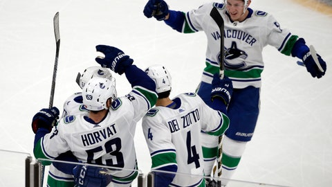 <p>               Vancouver Canucks defenseman Troy Stecher, top right, joins his teammates to celebrate a goal by center Bo Horvat (53) during the third period of an NHL hockey game against the Boston Bruins, Thursday, Nov. 8, 2018, in Boston. The Canucks won 8-5. (AP Photo/Elise Amendola)             </p>