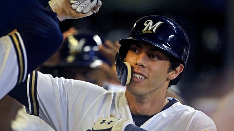 <p>               FILE - In this Monday, Sept. 17, 2018 file photo, Milwaukee Brewers' Christian Yelich is congratulated by teammates in the dugout after hitting a two-run home run during the fifth inning of a baseball game against the Cincinnati Reds in Milwaukee. Milwaukee outfielder Christian Yelich was a runaway winner for the National League Most Valuable Player award after helping the Brewers return to the playoffs for the first time in seven years. Yelich received 29 first-place votes and 415 points from the Baseball Writers' Association in balloting announced Thursday, Nov. 15, 2018. (AP Photo/Aaron Gash, File)             </p>