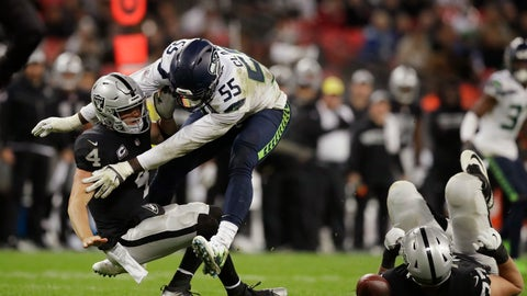 <p>               FILE - In this Oct. 14, 2018, file photo, Oakland Raiders quarterback Derek Carr (4) is sacked by Seattle Seahawks defensive end Frank Clark (55) during the second half of an NFL football game at Wembley stadium in London. After being well protected his first four seasons, Carr has been under heavy pressure the past few weeks and the results have not been good. (AP Photo/Matt Dunham, File)             </p>