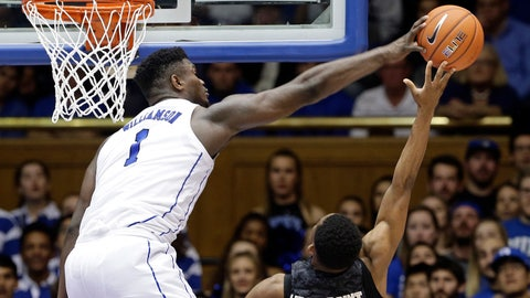 <p>               Duke's Zion Williamson,left, blocks a shot by Army's Josh Caldwell, right, during the second half of an NCAA college basketball game in Durham, N.C., Sunday, Nov. 11, 2018. Duke won 94-72. (AP Photo/Gerry Broome)             </p>