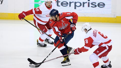 <p>               Washington Capitals left wing Alex Ovechkin, center, of Russia, skates with the puck between Detroit Red Wings left wing Justin Abdelkader, right, and defenseman Danny DeKeyser (65) during the third period of an NHL hockey game Friday, Nov. 23, 2018, in Washington. The Capitals won 3-1. (AP Photo/Nick Wass)             </p>