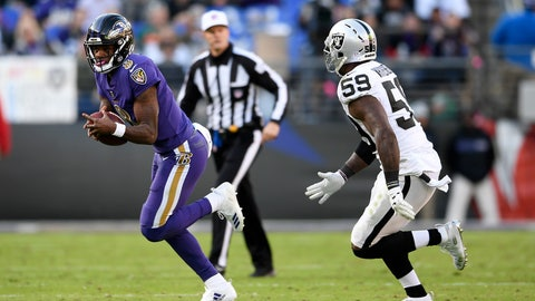 <p>               Baltimore Ravens quarterback Lamar Jackson, left, rushes past Oakland Raiders outside linebacker Tahir Whitehead in the first half of an NFL football game, Sunday, Nov. 25, 2018, in Baltimore. (AP Photo/Nick Wass)             </p>