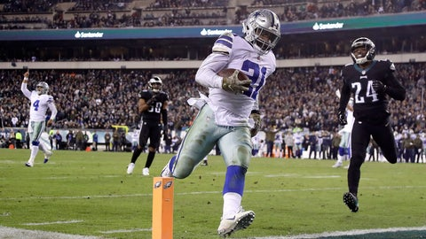 <p>               Dallas Cowboys running back Ezekiel Elliott (21) scores on a touchdown pass from quarterback Dak Prescott (4) as Philadelphia Eagles free safety Corey Graham (24) tries to stop him during the second half of an NFL football game, Sunday, Nov. 11, 2018, in Philadelphia. (AP Photo/Matt Slocum)             </p>