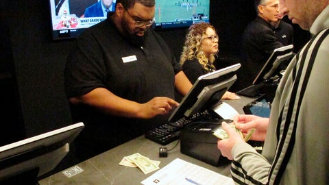 <p>               In this Nov. 20, 2018, photo a customer makes a sports bet at Resorts Casino in Atlantic City, N.J. Professional sports leagues that once vehemently fought sports betting are now partnering with gambling companies to get in on it now that it's legal. (AP Photo/Wayne Parry)             </p>