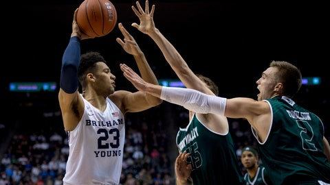 <p>               BYU forward Yoeli Childs (23) looks to pass the ball past Utah Valley center Richard Harward (55) and guard Jake Toolson (2) during an NCAA college basketball game Friday, Nov. 9, 2018, in Provo, Utah. (Isaac Hale/The Daily Herald via AP)             </p>