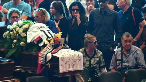 <p>               FILE - In this Aug. 18, 2018 file photo, a Genoa soccer team jersey and scarf drape the coffin of a victim of a collapsed highway bridge, during a funeral for some of the victims, in Genoa's exhibition center Fiera di Genova, Italy. In the more than three months since 43 people were killed in the Morandi highway bridge collapse, Genoa's residents have had little to smile about. The city derby on Sunday, Nov. 25, 2018 ,the first meeting between Genoa and Sampdoria since the bridge tragedy, could provide an opportunity for some relief. (Luca Zennaro/ANSA via AP, file)             </p>