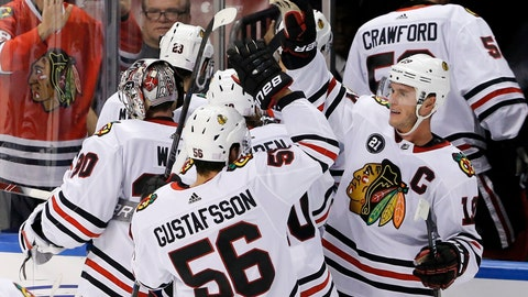 <p>               Chicago Blackhawks defenseman Erik Gustafsson (56) is congratulated by center Jonathan Toews, right, after Gustafsson's overtime goal to defeat the Florida Panthers 5-4 in an NHL hockey game Saturday, Nov. 24, 2018, in Sunrise, Fla. (AP Photo/Joe Skipper)             </p>