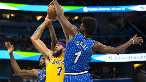 <p>               Orlando Magic forward Jonathan Isaac (1) blocks Los Angeles Lakers center JaVale McGee (7) shot as center Mo Bamba also defends during the first half of an NBA basketball game, Saturday, Nov. 17, 2018, in Orlando, Fla. (AP Photo/Willie J. Allen Jr.)             </p>