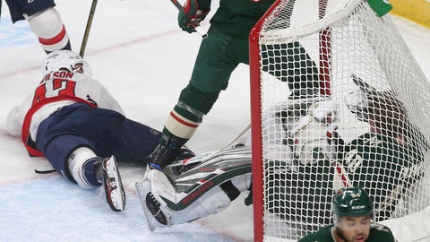 <p>               Washington Capitals' Tom Wilson, top left, looks back on his goal against Minnesota Wild goalie Devan Dubnyk, right, crashing into him in the first period of an NHL hockey game Tuesday, Nov. 13, 2018, in St. Paul, Minn. Wilson returned to the lineup after his 20-game suspension was reduced to 14 by a neutral arbitrator. After the goal Wilson received a two-minute penalty for goaltender interference. (AP Photo/Jim Mone)             </p>