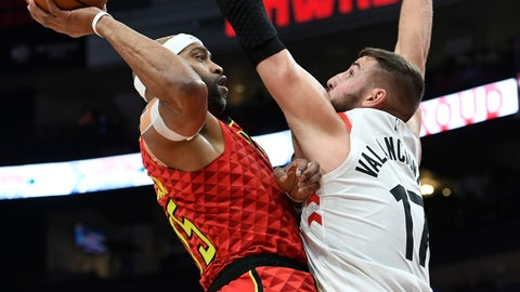 <p>               Atlanta Hawks forward Vince Carter shoots over Toronto Raptors center Jonas Valanciunas during the first half of an NBA basketball game Wednesday, Nov. 21, 2018, in Atlanta. (AP Photo/John Amis)             </p>