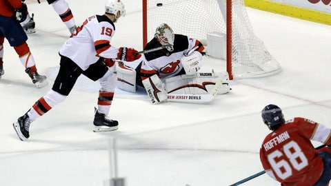 <p>               Florida Panthers left wing Mike Hoffman (68) scores the winning goal past New Jersey Devils goaltender Keith Kinkaid during overtime of an NHL hockey game, Monday, Nov. 26, 2018, in Sunrise, Fla. (AP Photo/Lynne Sladky)             </p>