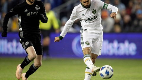 <p>               Portland Timbers midfielder Diego Valeri (8) shoots on net ahead of Sporting Kansas City midfielder Ilie Sanchez, left, during the first half in the second leg of the MLS soccer Western Conference championship in Kansas City, Kan., Thursday, Nov. 29, 2018. (AP Photo/Orlin Wagner)             </p>